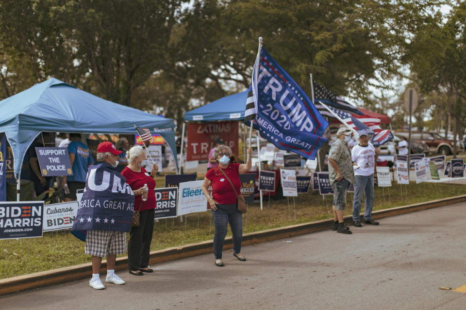 Supporters of President Donald Trump outside a polling place with early voting in Westchester, Fla., Oct. 24, 2020. (Saul Martinez/The New York Times)