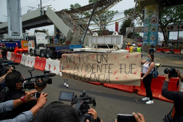 'It was not an accident, it was negligence' reads the sign at the site of the metro line crash in Mexico City