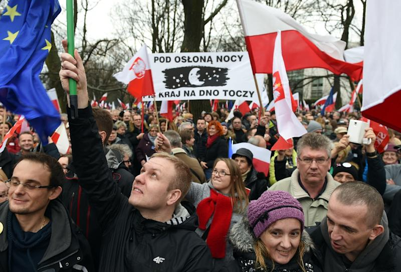 Protesters shout slogans during an anti government demonstration in Warsaw on December 19, 2015 (AFP Photo/Janek Skarzynski)