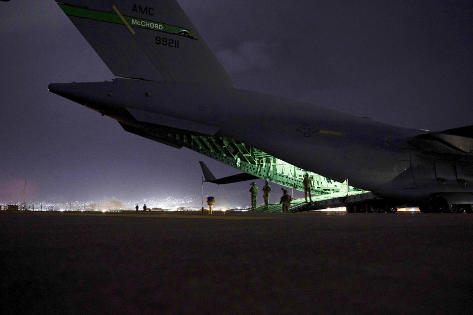 FILE - In this Aug. 30, 2021 photo provided by the U.S. Air Force, an Air Force aircrew, assigned to the 816th Expeditionary Airlift Squadron, prepares to receive soldiers, assigned to the 82nd Airborne Division, to board a U.S. Air Force C-17 Globemaster III aircraft in support of the final noncombatant evacuation operation missions at Hamid Karzai International Airport in Kabul Afghanistan. The Taliban, which is in need of foreign aid, has said it will allow people with valid travel papers to leave, and the international community says it will be monitoring to see if they keep their word. (Senior Airman Taylor Crul/U.S. Air Force via AP)