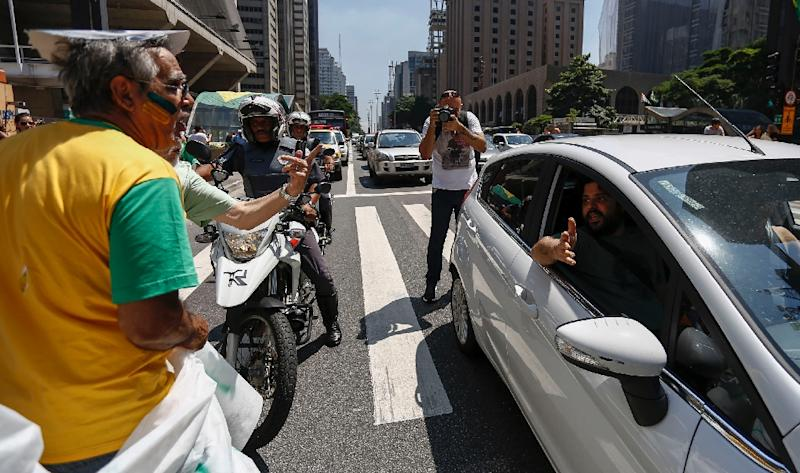 Pro- and anti-government demonstrators argue on Paulista Avenue in Sao Paulo, Brazil on March 19, 2016
