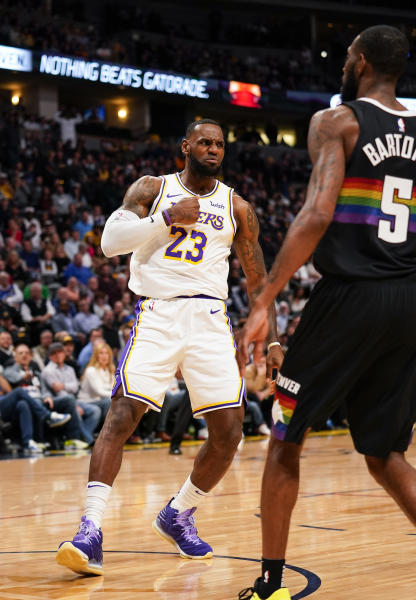 Los Angeles Lakers forward LeBron James reacts to a dunk against the Denver Nuggets during the first quarter an NBA basketball game Tuesday, Dec. 3, 2019, in Denver. (AP Photo/Jack Dempsey)