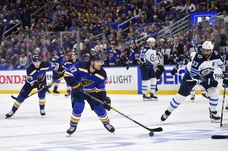 Apr 20, 2019; St. Louis, MO, USA; St. Louis Blues left wing Jaden Schwartz (17) handles the puck during the third period in game six of the first round of the 2019 Stanley Cup Playoffs against the Winnipeg Jets at Enterprise Center. Mandatory Credit: Jeff Curry-USA TODAY Sports