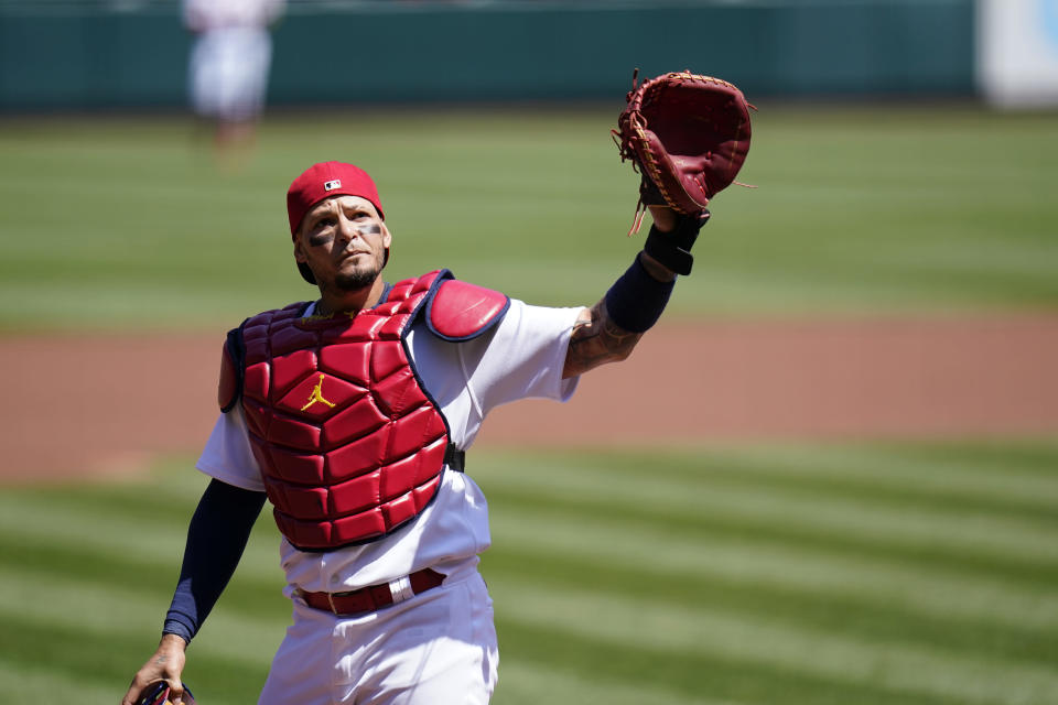 St. Louis Cardinals catcher Yadier Molina waves to cheering fans after starting a baseball game against the Washington Nationals and becoming the first catcher in major league history to catch 2000 games with one team Wednesday, April 14, 2021, in St. Louis. (AP Photo/Jeff Roberson)