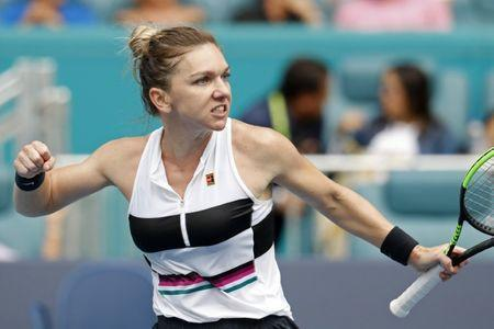 Mar 24, 2019; Miami Gardens, FL, USA; Simona Halep of Romania celebrates after winning the second set against Polona Hercog of Slovenia (not pictured) in the third round of the Miami Open at Miami Open Tennis Complex. Mandatory Credit: Geoff Burke-USA TODAY Sports