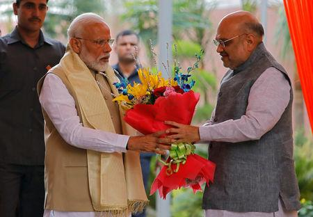 India's Prime Minister Narendra Modi receives a flower bouquet from the Bharatiya Janata Party (BJP) President Amit Shah upon his arrival to attend a thanksgiving ceremony by BJP leaders to its allies at the party headquarters in New Delhi, India, May 21, 2019. REUTERS/Anushree Fadnavis