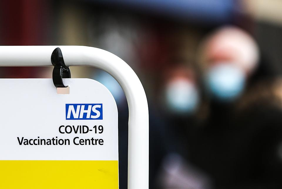 People queue to receive their Covid-19 vaccine at a vaccination centre inside the Brighton Centre, Sussex, as the UK continues in a third lockdown due to the coronavirus pandemic. Picture date: Tuesday February 9, 2021.