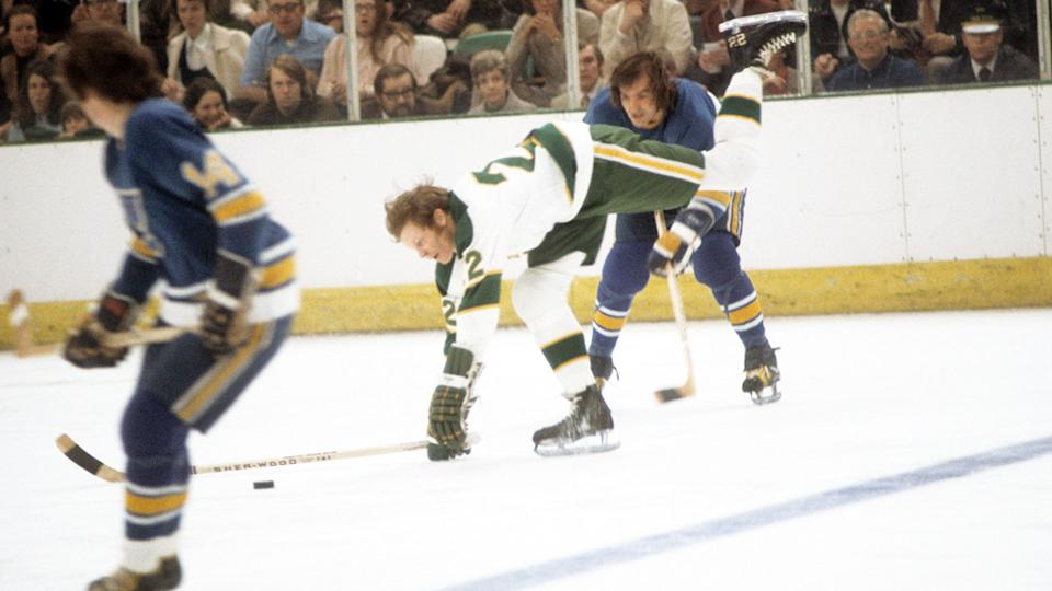 Bob Plager, pictured here checking Dennis Hextall during the NHL Quarter-Finals in 1972.