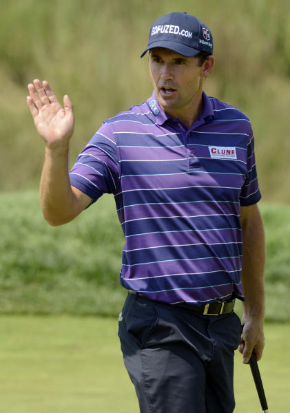 Padraig Harrington of Ireland, waves after making a birdie putt on the 16th hole during the first round of The Barclays golf tournament at Bethpage State Park in Farmingdale, N.Y., Thursday, Aug. 23, 2012. (AP Photos/Henny Ray Abrams)