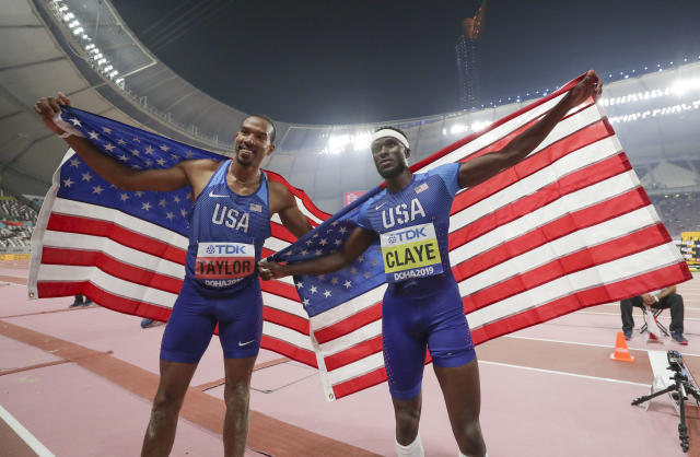 Christian Taylor, left, of the United States, and Will Claye, of the United States, pose together after the men's triple jump final at the World Athletics Championships in Doha, Qatar, Sunday, Sept. 29, 2019. Taylor won the gold medal and Claye won the silver. (AP Photo/Hassan Ammar)