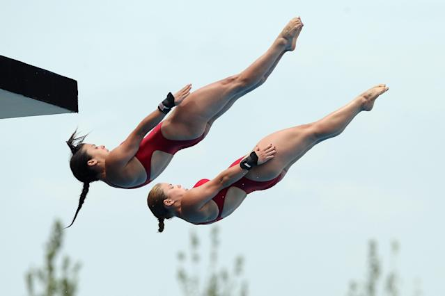 SHANGHAI, CHINA - JULY 18: Meaghan Benfeito and Roseline Filion of Canada compete in the Women's 10m Platform Synchro preliminary round during Day Three of the 14th FINA World Championships at the Oriental Sports Center on July 18, 2011 in Shanghai, China. (Photo by Zhang Lintao/Getty Images)