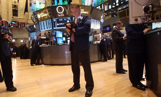 A stock trader works the floor of the New York Stock Exchange on April 23, when the market dropped sharply due to a hacked Twitter account.