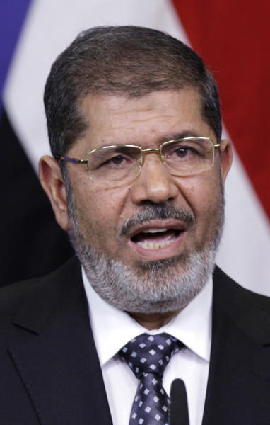 FILE- In this Sept. 13, 2012 file photo, Egyptian President Mohamed Morsi gestures while speaking during a media conference at EU headquarters in Brussels. Morsi will speak at the Clinton Global Initiative annual meeting starting Sunday, Sept. 23, 2012, New York. (AP Photo/Virginia Mayo, File)
