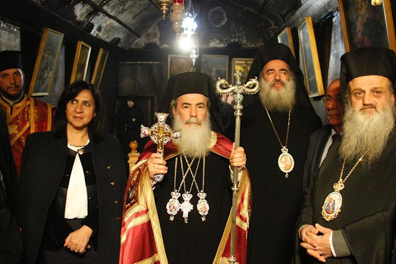 greek orthodox patriarch of jerusalem theophilos iii centre stands inside the church of the