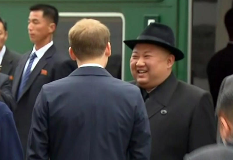 In this image taken from the RU-RTR Russian television, North Korean leader Kim Jong Un smiles as he leaves a train in Vladivostok railway station in Vladivostok, Russia, Wednesday, April 24, 2019. North Korean leader Kim Jong Un arrived in Russia by train on Wednesday, a day before his much-anticipated summit with President Vladimir Putin that comes amid deadlocked diplomacy on his nuclear program. (RU-RTR Russian Television via AP)