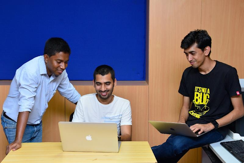 "Most ""ethical hackers"" -- like Anand Prakash (C), Shashank (R) and Rohit Raj (L) seen here -- are software engineers swelling the ranks of India's $154-billion IT outsourcing sector whose skill set makes them uniquely gifted at cracking cyber systems (AFP Photo/MANJUNATH KIRAN)"