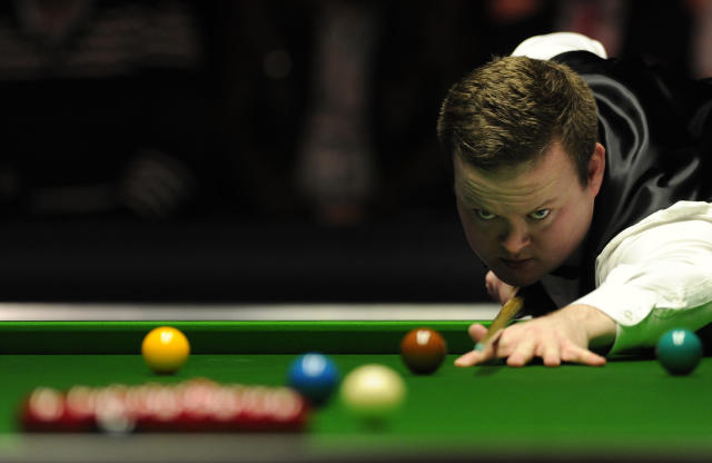 Shaun Murphy of England plays a shot against John Higgins of Scotland during the semi-final match in the BGC Masters snooker tournament at Alexandra Palace in north London on January 21, 2012. AFP PHOTO / CARL COURT (Photo credit should read CARL COURT/AFP/Getty Images)