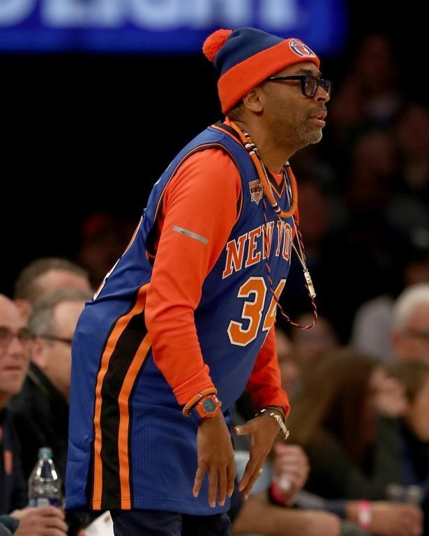 Lee is a rabid fan of his hometown New York Knicks -- he is seen here in full team colors at a game in Madison Square Garden in 2017