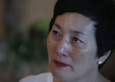 Kim Young-ja, a sister of Kim Young-nam who is a South Korean abductee living in North Korea, cries during an interview with Reuters in Jeonju July 2, 2014. REUTERS/Kim Hong-Ji