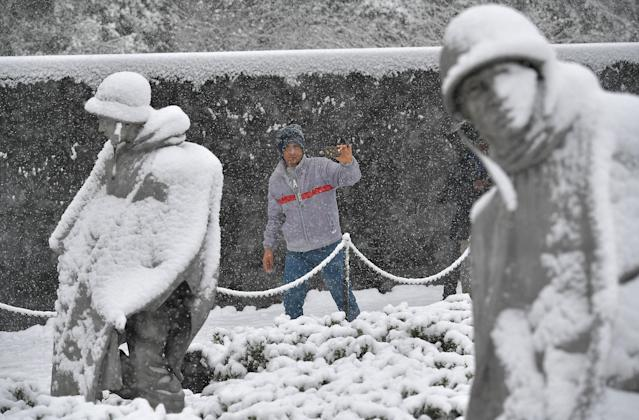 <p>Tourists visit the Korean War Memorial during a snow storm in Washington, DC, March 21, 2018. (Photo: Mandel Ngan/AFP/Getty Images) </p>