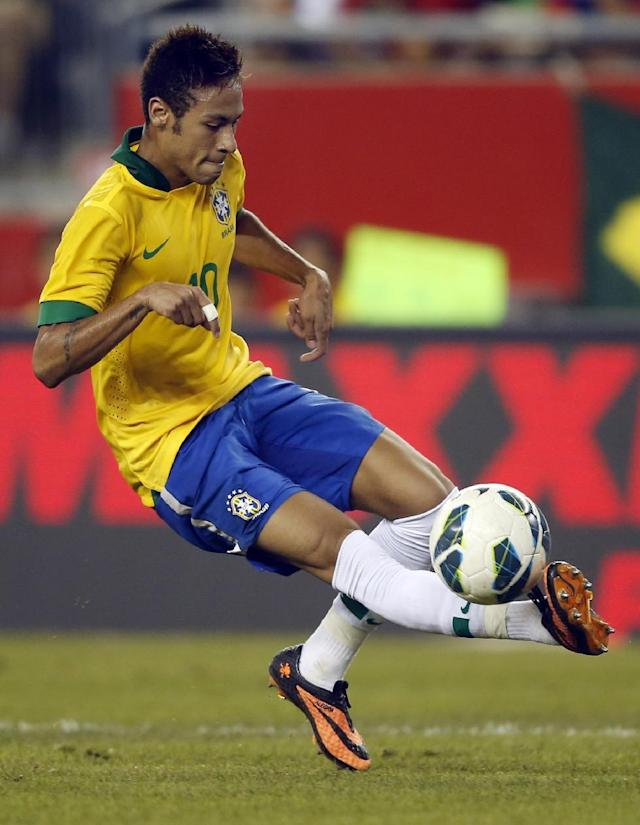 FILE - In this Sept. 10, 2013 file photo, Brazil's Neymar (10) controls the ball against Portugal during the second half of a friendly soccer match, in Foxborough, Mass. (AP Photo/Elise Amendola, File)