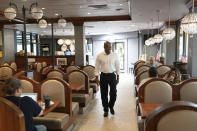 Eric Adams, the Democratic candidate for New York mayor, walks into a Brooklyn diner, Wednesday, Aug. 4, 2021, in New York. (AP Photo/Mark Lennihan)