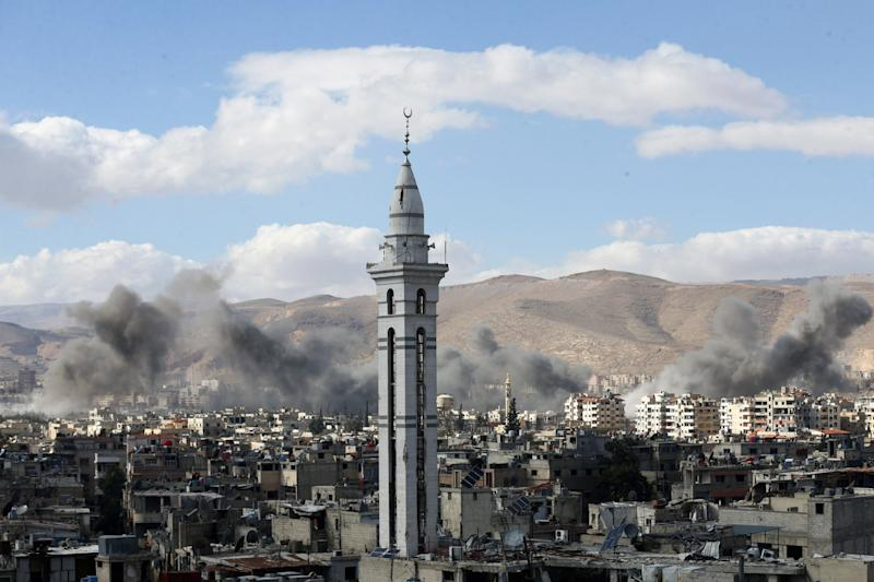 Smoke rises from the besieged Eastern Ghouta in Damascus