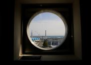 The storage tanks for treated water are seen through a window at the tsunami-crippled Fukushima Daiichi nuclear power plant in Okuma town