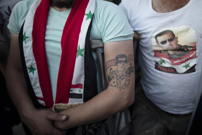 An Injured Syrian soldier with a tattoo of President Bashar Assad as they celebrate at Omayyad Square, in Damascus, Syria, Thursday, May 27, 2021. (AP Photo/Hassan Ammar)