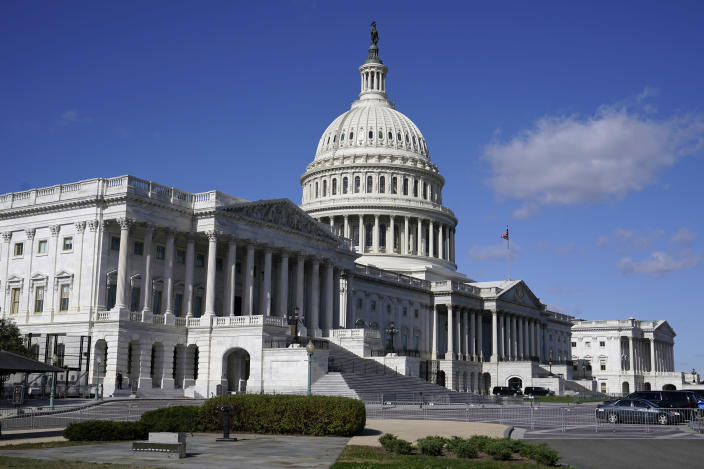 """FILE - In this Nov. 2, 2020, file photo sunlight shines on the U.S. Capitol building on Capitol Hill in Washington. President-elect Joe Biden wants to """"restore the soul of America."""" First, he'll need to fix a broken and divided Congress. (AP Photo/Patrick Semansky, File)"""