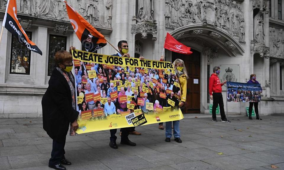 Protesters unfurl a banner outside the supreme court in London in support of Heathrow expansion