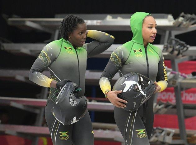 Jamaica's Jazmine Fenlator-Victorian, right, and Carrie Russell were the first women from their country to compete in bobsled.