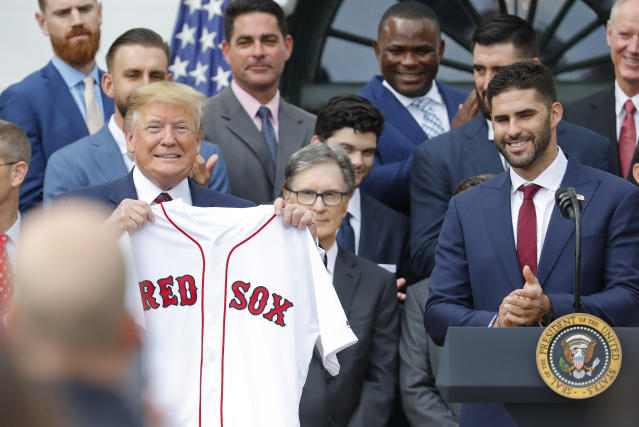 President Donald Trump, left, holds a team jersey that was presented to him by outfielder J.D. Martinez, right, during a ceremony on the South Lawn of the White House in Washington, Thursday, May 8, 2019, where Trump honored the 2018 World Series Baseball Champion Boston Red Sox. (AP Photo/Pablo Martinez Monsivais)