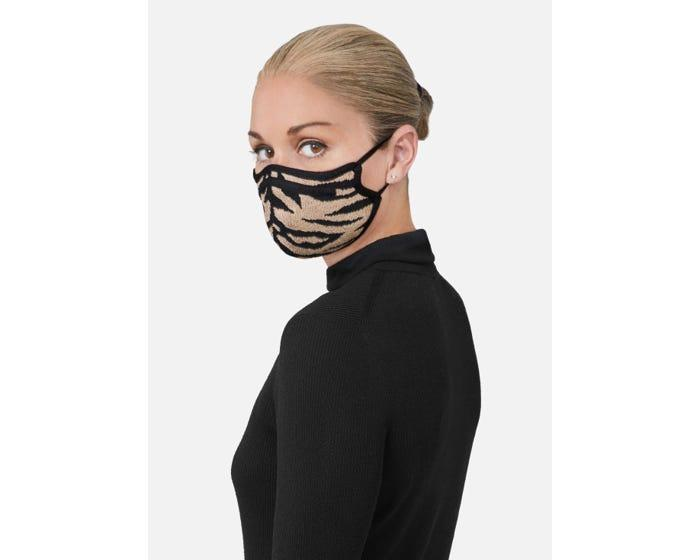 """<h3><a href=""""https://fave.co/2L6r1Qg"""" rel=""""nofollow noopener"""" target=""""_blank"""" data-ylk=""""slk:St. John Camel Pique Animal Print Care Mask"""" class=""""link rapid-noclick-resp"""">St. John Camel Pique Animal Print Care Mask</a></h3> <br>American luxury house St. John launched a striking selection of limited-edition Care Masks that are sustainably crafted from surplus pique fabric. Plus, when you buy one of these masks, St. John will donate three non-surgical antimicrobial masks to those in need. <br><br><br><br><strong>St. John Collection</strong> Camel Pique Animal Print Care Mask, $, available at <a href=""""https://go.skimresources.com/?id=30283X879131&url=https%3A%2F%2Ffave.co%2F2L6r1Qg"""" rel=""""nofollow noopener"""" target=""""_blank"""" data-ylk=""""slk:St. John"""" class=""""link rapid-noclick-resp"""">St. John</a><br><br><br>"""