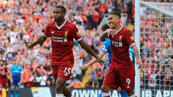 PHOTO: Liverpool's Daniel Sturridge, left, celebrates scoring his side's fourth goal of the game against Arsenal during their English Premier League soccer match at Anfield, Liverpool, England, Sunday Aug. 27, 2017. (Peter Byrne/AP)