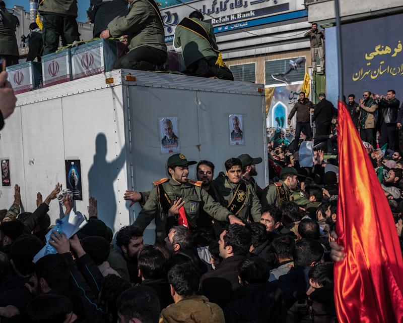 Soleimani's coffin is surrounded by throngs in Tehran's Enghelab Square on Jan. 6. | Newsha Tavakolian—Magnum Photos for TIME