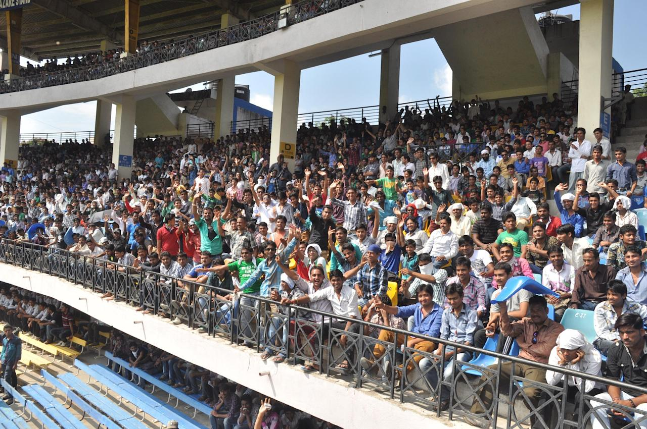 Spectators during during NKP Salve Challenger Trophy between India Blue and Delhi at Holkar Cricket Stadium in Indore on Sept. 26, 2013. (Photo: IANS)