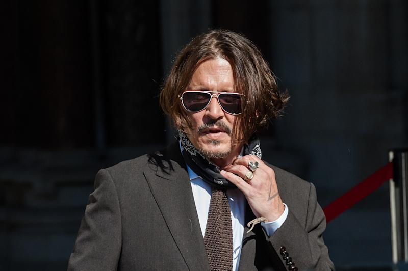 LONDON, UNITED KINGDOM - JULY 10, 2020: Johnny Depp arrives at the Royal Courts of Justice on the fourth day of the hearing on the libel case against The Sun newspaper on 10 July, 2020 in London, England. Johnny Depp is suing The Suns publisher, News Group Newspapers, over a 2018 article in which he was accused of being violent towards his ex-wife Amber Heard during their marriage.- PHOTOGRAPH BY Wiktor Szymanowicz / Barcroft Studios / Future Publishing (Photo credit should read Wiktor Szymanowicz/Barcroft Media via Getty Images)