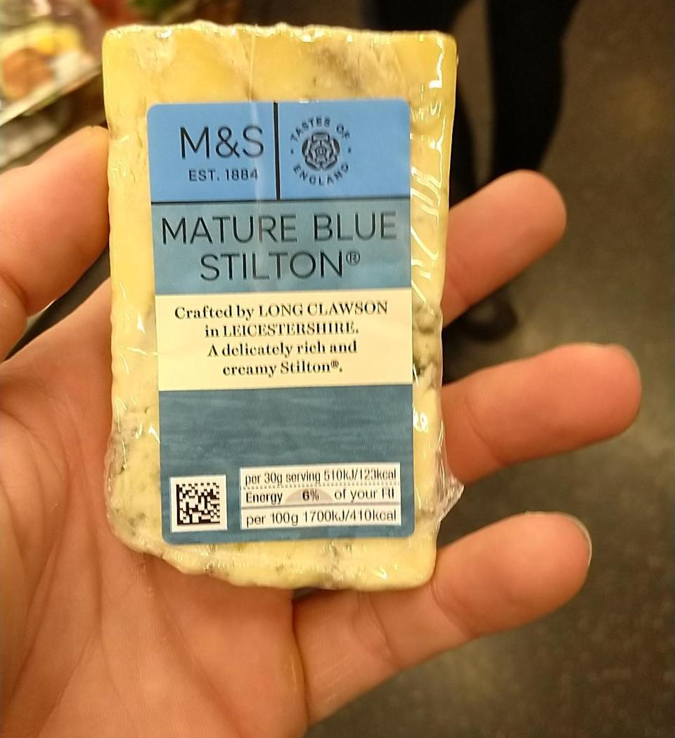 A piece of Mature Blue Stilton cheese is pictured.