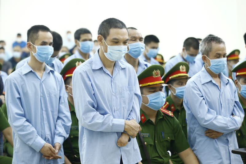 Vietnam sentences brothers to death over bloody land clash