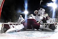 <p>Goaltender Philipp Grubauer #31 of the Colorado Avalanche stretches to make a save against the Vegas Golden Knights during the second period of the 2021 Bridgestone NHL Outdoors Saturday on the 18th fairway of the Edgewood Tahoe Resort, at the south shore of Lake Tahoe on February 20, 2021 in Stateline, Nevada. (Photo by Brian Babineau/NHLI via Getty Images)</p>