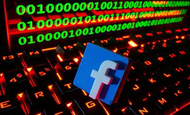 A 3D printed Facebook logo is pictured on a keyboard in front of binary code in this illustration taken September 24, 2021. REUTERS/Dado Ruvic/Illustration (Photo: Dado Ruvic via Reuters)
