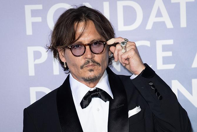 Johnny Depp posing for the media at the Gala For Planetary Health in 2020 (Photo: SC Pool - Corbis / Corbis / Getty Images)