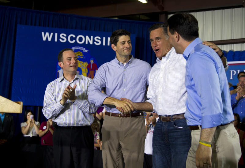 FILE - In this June 18, 2012, file photo RNC chairman Reince Priebus, right, Rep. Paul Ryan, R-Wis., Republican presidential candidate, former Massachusetts Gov. Mitt Romney, and Gov. Scott Walker, R-Wis., left, arrive at a campaign event in Janesville, Wis. Priebus said on a talk show Sunday Aug. 26, 2012, that Republican candidate Todd Akin's insistence on staying in the Missouri Senate race could cost the party its chance to win control of the Senate.  (AP Photo/Evan Vucci, File)