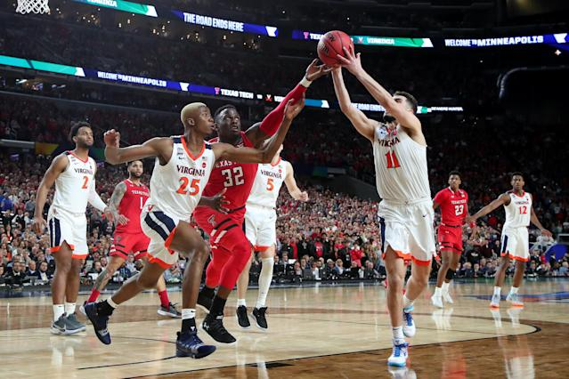 Mamadi Diakite #25 and Ty Jerome #11 of the Virginia Cavaliers battles for the ball with Norense Odiase #32 of the Texas Tech Red Raiders in the second half during the 2019 NCAA men's Final Four National Championship game at U.S. Bank Stadium on April 08, 2019 in Minneapolis, Minnesota. (Photo by Tom Pennington/Getty Images)