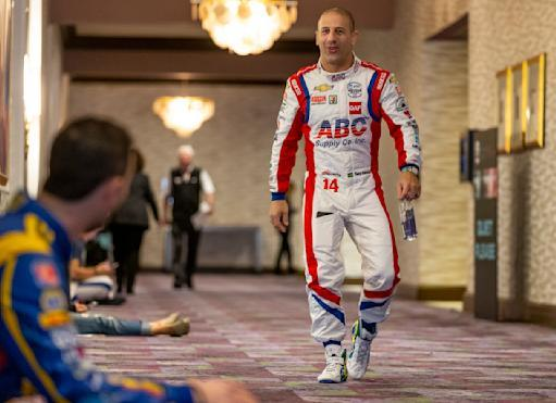 IndyCar driver Tony Kanaan, right, speaks with fellow driver Alexander Rossi between interviews during IndyCar auto racing media day, Monday, Feb. 11, 2019, in Austin, Texas. (AP Photo/Stephen Spillman)