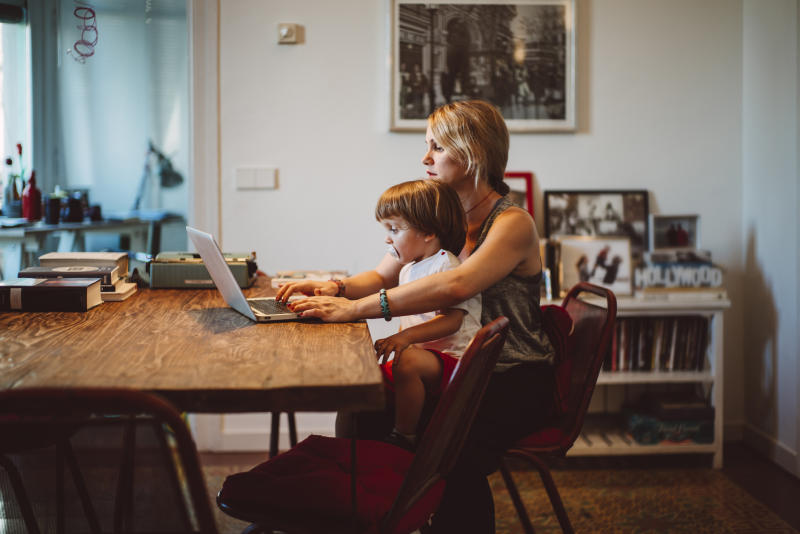 Many parents have found themselves in the role of carer, and teacher, while still juggling work. (Getty Images)