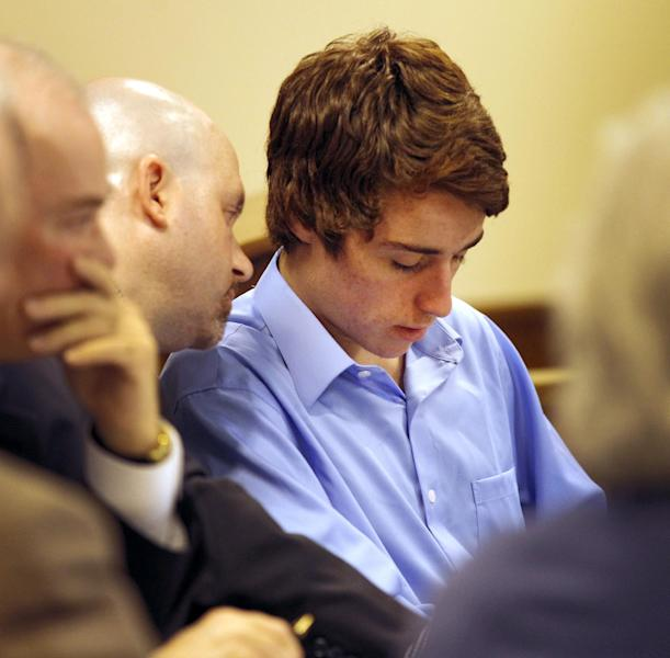 T.J. Lane, right, talks with his attorney Ian Friedman at Juvenile Court in Chardon, Ohio, on Wednesday, May 2, 2012. Lane is charged in the Feb. 27 Chardon High School rampage that left three students dead and two students seriously wounded. (AP Photo/Amy Sancetta)