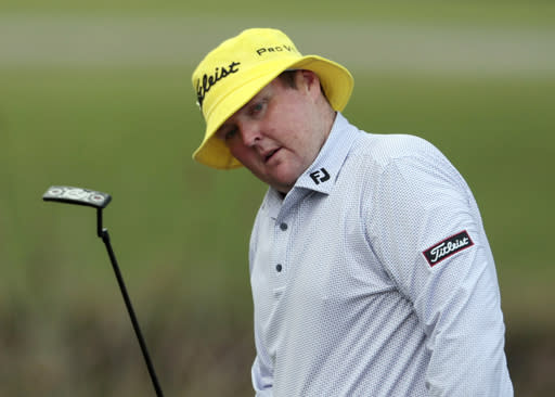 "FILE - In this April 23, 2015 file photo, Jarrod Lyle, of Australia, reacts after missing a putt on the 17th hole during the first round of the Zurich Classic PGA golf tournament in Avondale, La. Lyle's wife says the Australian golfer is struggling through a ""really scary"" period in his third battle with cancer. (AP Photo/Butch Dill, File)"