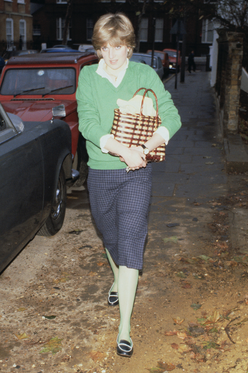 <p>Do our eyes deceive us, or is Diana wearing lime green tights to match her preppy V-neck jumper? It really looks like it tbh, and we're very here for such an edgy style move from the soon-to-be-royal, who completed the look with a woven basket and checked skirt. </p>